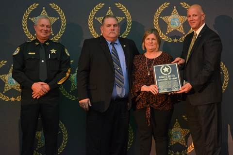 Suwannee County Sheriff Sam St. John, Kin Weaver, Gayle Weaver Crespo, and FSA President Pinellas County Sheriff Bob Gualtier